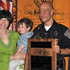 Tribune-Star/Joseph C. Garza<br /> Proud family: Indiana State Trooper Kris Fitzgerald poses for a photo with his wife, Amy Fitzgerald, and son, Austin, 4, after he was awarded the Kevin Artz Outstanding Law Enforcement Officer of the Year Thursday by the Terre Haute Breakfast Optimist Club at Clabber Girl.
