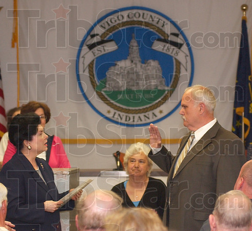 I will: Vigo County Clerk Pat Mansard givs the oath of office to newly elected Commissioner Mike Ciolli after the caucus Thursday evening.