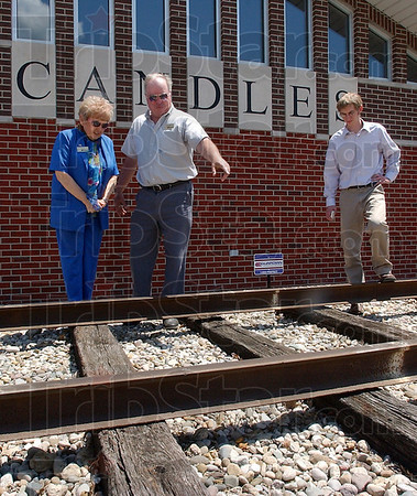 Just right: David Black, a friend of the C.A.N.D.L.E.S. Museum talks with Eva Kor about the placing of the railroad rails in front of the building. With them is Kiel Majewski.
