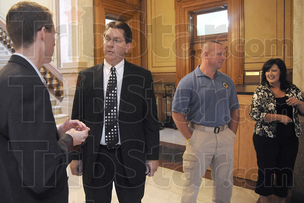 Support: Mayor Duke Bennett waits for the start of his court case in the State House Thursday morning. At right is Terre Haute police chief John Plasse and Pam Bennett.