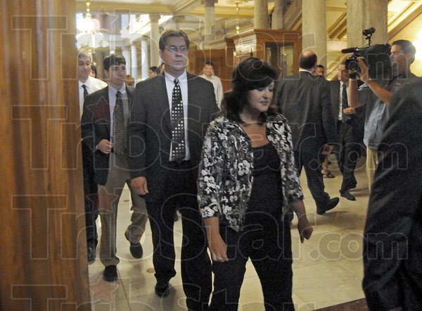 Bennett: Terre Haute Mayor Duke Bennet follows his wife Pam into the Indiana Supreme Courtroom Thursday morning to have his case heard.
