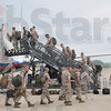 Tribune-Star/Joseph C. Garza<br /> All aboard: Marines with Company K, 3rd Battalion, 24th Marines, board an Air Tran Boeing 737 at the Terre Haute International Airport Thursday bound for California.