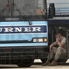 Tribune-Star/Joseph C. Garza<br /> Making those last minute pre-deployment calls: U.S. Marine Corps Sgt. Lucas Caldwell of Company K, 3rd Battalion, 24th Marines, finds a spot in the cargo area of a charter bus to make a phone call Thursday at the Terre Haute International Airport.