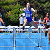 One more: Erica Moore clears the last hurdle of the 400 meter race and went on to add that championship to her total.