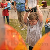 """Tribune-Star/Joseph C. Garza<br /> After his brother, Skyler Tubb, left, 9, won his plastic blow up hammer, Ethan Tubb, 5, tried his hand at the """"High Striker"""" Sunday at the Fairbanks Park Music and Arts Festival."""