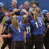 Tribune-Star/Joseph C. Garza<br /> Home run helmet pat: As the umpire watches to make sure she touches home plate, Indiana State's Audrey Childress is mobbed by her teammates after she hit a fifth-inning home run against Southern Illinois Sunday at Price Field.