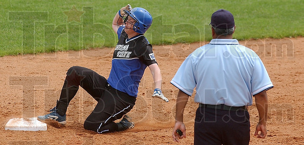 Tribune-Star/Joseph C. Garza<br /> Double in the fifth: Indiana State's Sam Markowski slides safely into second base under the watchful eye of an umpire after she hit a double in the fifth-inning of the Sycamores' game against Southern Illinois Sunday at Price Field.