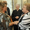 Tribune-Star/Joseph C. Garza<br /> Taking the next step: Vigo County Drug Court participant Lori Cartwright is congratulated by Judge Barbara Brugnaux and the court's case manager, Eve Fears, for beginning Phase Four of the program Friday in the Vigo County Courthouse.