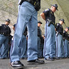 Prayer: Indiana State Police officers bow their heads for a prayer for those members of the department that lost their lives in the line of duty during a ceremony at Forrest Park in Brazil Friday morning.