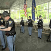 Roll call: Indiana State Police Capt. Danny Price (L) and Lt. Mike Eslinger read the names of officers killed in the line of duty during Friday's memorial service at Forrest Park in Brazil.