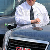 No news: Mark Fuson poses with GMCs hybrid Yukons. The longtime General Motors dealer did not recieve word from corporate on his business' status.