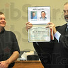 Tribune-Star/Joseph C. Garza<br /> Before and a better after: Vigo County Drug Court graduate Jon Hartmann smiles as Judge Mike Rader displays Hartmann's before and after photos with his program diploma Friday in the Vigo County Courthouse.