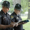 Roll call: Indiana State Police Capt. Danny Price (L) and Lt. Mike Eslinger read the names of officers killed in the line of duty during Friday's memorial ceremony at Forrest Park in Brazil.