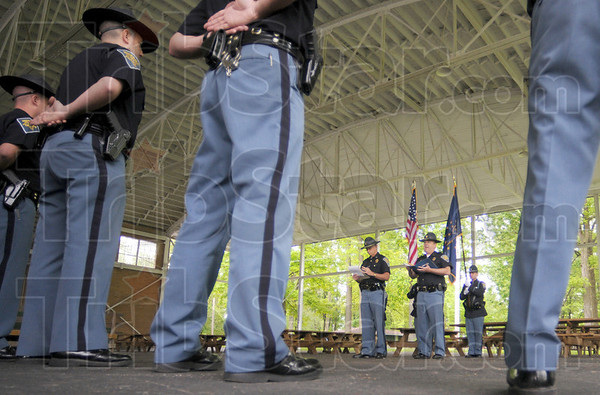 Memorial service: Indiana State Police troopers participate in a memorial service at Forrest Park in Brazil honoring officers that lost their lives in the line of duty.