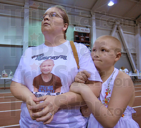 Good cause: Heather Sutton and her daughter Karsyn Worthington talks with a reporter at the beginning of the Relay For Life Friday evening at Rose-Hulman. Karsyn is recovering from leukemia.