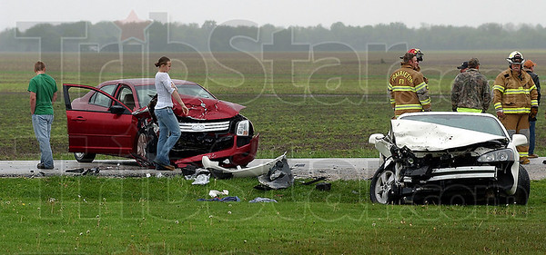 Again: There was yet another automobile accident on State Road 63 just south of Sutliff drive. Friday afternoon the two cars hit head on after the white car drifted left of center according to law enforcemnent officials at the scene. Four people were taken away by ambulance with two of those going to Riley Hospital in Indianapolis.