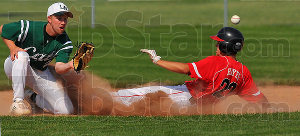 Early arrival: Jacob Hayes slides safely into second base well ahead of the throw to Lawerence North secondbaseman Alex Meadows.