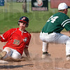 Safe at  third: Braves baserunner Logan Buske arives safely at third base wel ahead of the throw to Lawrence North's Phil Schwenk.