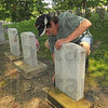 Each year: Michael Houser cleans the moss from his father's stone at Highland Lawn Cemetery. Each year he comes to clean the grave markers of his father, grandfather and brother.