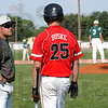 Strategies: Terre Haute South head baseball coach Kyle Kraemer talks with batter Logan Buske while Wildcat's coach Richard Winzenread meets on the mound with his pitcher Elijah Linder and catcher Brandon Meixner.