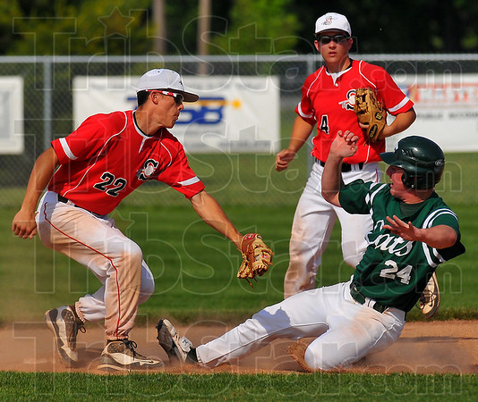 Safe: Lawrence North baserunner slides under the tag of Brave Jacob Hayes while secondbaseman Ricky Wheatfill watches.