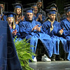 Sounds of success: McLean High School students like the sound of the applause as they participate in Friday's graduation ceremony in the South High School auditorium.