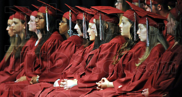 Faces of success: Members of the Washington High School graduating class listen to a student speaker during Friday's graduation ceremonies.