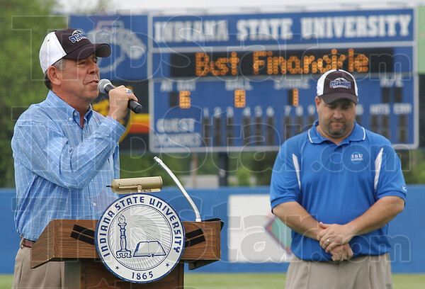 Honored: Bob Warn thanks all involved for the decision to rename Sycamore Field in his honor. With him is assistant athletic director John Sherman.
