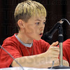 Battle: Sugar Grove student Tony Smodilla responds correctly to a question during the Battle of the Books at Fayette Elementary School Friday morning.