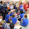 Prep: A group of Lost Creek Elementary School kids (blue shirts) wait their turn to participate in the Battle of the Books at Fayette Elementary School Friday morning.