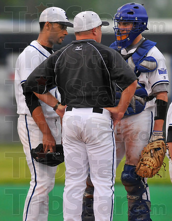 Calming influence: ISU assistant coach Tyler Herbst chats with pitcher Eric Valdez and catcher Bronco Lafrenz halfway through the Sycamore's game with Evansville Friday night.