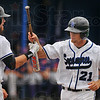 You'll need this again: Nick Cioli hands Brady Shoemaker his bat back after Shoemaker hit a first inning homerun against Evansville Friday night.