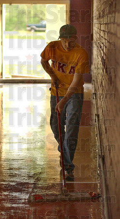 End of the day: Rose-Hulman student Chad Conway mops the floor of the gym on the fraternity grounds Saturday. Saturday was PKA Work Day.
