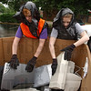 Neither rain nor...: Crystal Clapp and Becky Decker load discarded electronics in a box at the eScrap Super Saturday event yesterday. They were part of a youth group from World Gospel Church taking part in a 30 hour fast that volunteered to help at the collection site.