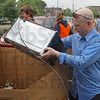 Loading up: Jeff Friesner, Walmart manager loads a microwave oven into a box of other discarded electronics.