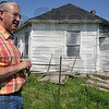 Tribune-Star/Joseph C. Garza<br /> A relic of another era: William Milner, a Lost Creek township native, is working to restore an old octagon house which is on property owned by his father and which is currently in serious disrepair due to vandalism and long-standing lack of use. The walls of the home were made using 6-by-2 inch wide pieces of lumber laid flat on top of each other, giving the home an almost indestructible feeling.