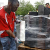 Wrapping things up: Anthony Smith of Work Force Inc. uses plastic wrap to secure a pallet of discarded televisions in place at the eScrap Super Saturday event yesterday.