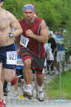 They're off: Tribune-Star reporter Brian Boyce #991 starts the 5K race through the Exotic Feline Rescue Center Saturday morning in Centerpoint.