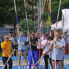 Warmin up: Contestants in the women's pole vault wait their turn as warmups begin Saturday afternoon.