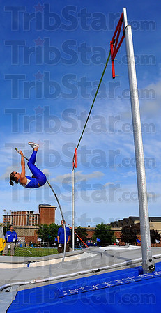 """True to form: Kylie Hutson lets the pole push her skyward as she competes in the pole vault Saturday evening. Hutson won the the event with a leap of 13'3""""."""