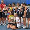 Tribune-Star/Joseph C. Garza<br /> One for the scrapbook: Members and coaching staff of the Terre Haute South girls' tennis team pose for photos with the sectional championship trophy Saturday at Terre Haute North.