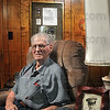 "Tribune-Star/Joseph C. Garza<br /> Surrounded by the memories of the corps: Brazil resident Melvin ""Jack"" Love displays his silver star on the wall behind him along with the letter and photos from his time in the U.S. Marine Corps. Love was part of the invasion force on Iwo Jima during World War II."