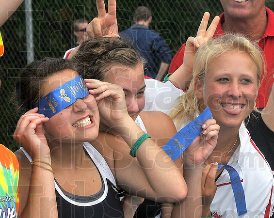Tribune-Star/Joseph C. Garza<br /> Sectional silliness: Terre Haute South tennis players Emma Bilyeu, Mallory Mentheny and Hunter Bullock mug for the camera after the presentation of the sectional championship trophy Saturday at Terre Haute North. Terre Haute North.