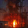 Cooling oil: Thick black smoke pours from transformers at CF Industries Friday night. According to Jeff Christian, site superintendant for CF Industries about 100 gallons of the oil used to cool the transformers went up in smoke.