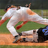 Tangled up: RHIT shortstop Tim Tepe trips over Defiance baserunner Alex Timofeev on a pickoff attempt.