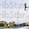 Enjoying the trip down: Indiana State pole vaulter Kylie Hutson clears the bar in the pole vault during the 2009 Pace Setter Invitational Saturday at Marks Field.