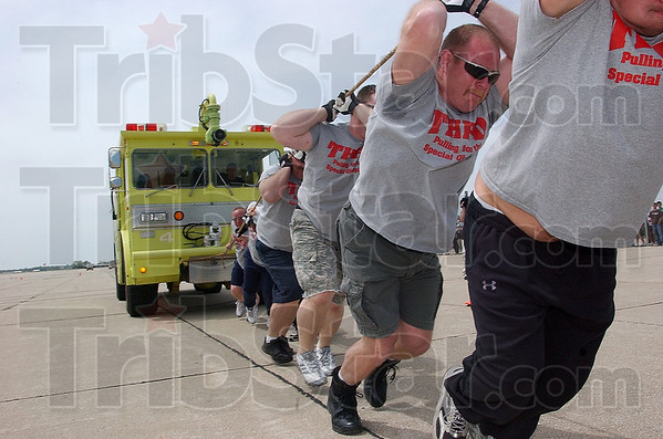 Tribune-Star/Joseph C. Garza<br /> Terre Haute Fire Department firefighter Dan Curley pulls a fire truck with his fellow firefighters during Pi Kappa Alpha's 2009 Fire Truck Pull fundraiser for Special Olympics Saturday at the Terre Haute International Airport-Hulman Field.