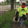 Tribune-Star/Joseph C. Garza<br /> Sporting the distinctive neon yellow Keep Terre Haute Beautiful T-shirt, city employee Genie Pearson scours Fourth Avenue for litter with fellow city hall employee, Traci Wells, Saturday, during the clean up.