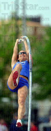 Tribune-Star/Joseph C. Garza<br /> On the way up: Indiana State pole vaulter Kylie Hutson bends the pole on her way up over the bar during the competition Saturday in the 2009 Pace Setter Invitational at Marks Field.
