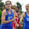 Tribune-Star/Joseph C. Garza<br /> Baton and encouragement: Indiana State's Rachel Posey takes the baton from teammate Mary Kate Conway during the 1600 relay Saturday during the Pacesetter Invitational at Marks Field.